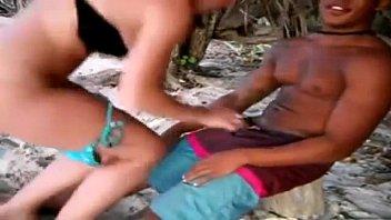 Shameless white girl on the beach cumming on black dick