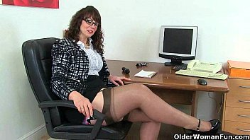 UK milf Red will assist you at the office today