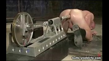 Patrick tied up and fucked by huge machines