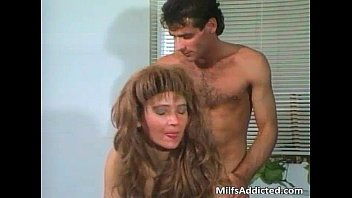 Brunette MILF with hairy cunt sucks cock