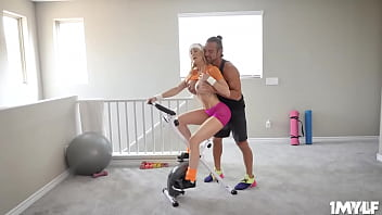 Amazing Milf Workouts While Riding A Pink Dilido On Her Stationary Bike
