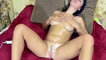 Insatiable girl plays with a Hitachi