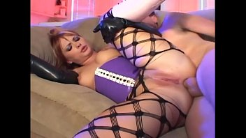 Redhead in fencenet pantyhose and latex gloves