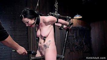 Brunette suffers pain in device bondage