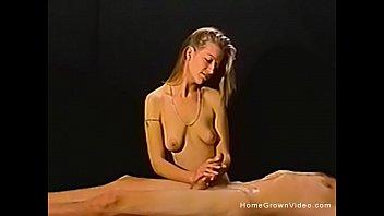 Petite amateur blonde gives a massage then a handjob