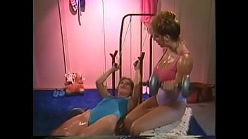 Redhaired floozie with big jugs Mindy Rae and her gym partner with gaunt figure and small tits decided to take some minutes as break from their physical excercises to speak low Genitalese