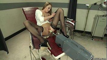 Babe in gyno chair fucks machine