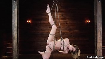Helpless blonde is tormented in hogtie