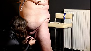 I hit my slave with clothespins applied to his fat body and small dick