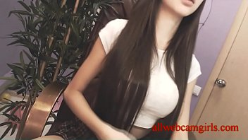 Long-haired cutie shows her big breasts