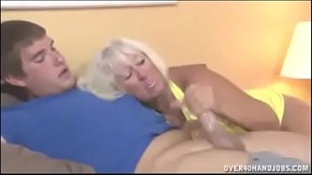 Hot mommy Jeannie Lou gives handjob to young boy