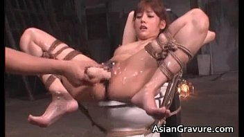 Cute asian babe in bondage sex gets
