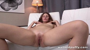 Long haired babe rubbing her smooth clit