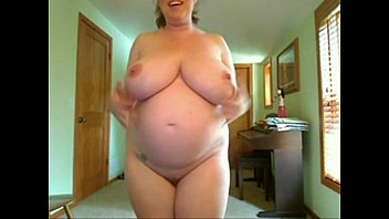 Pregnant Women With Big Tits Fucks Herself Standing on 4xcams.com Image