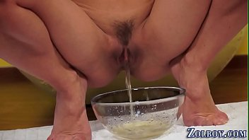 Young European Girl Masturbates and Pees in a Bowl