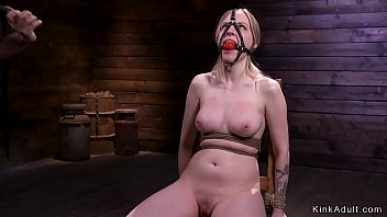 Gagged brunette whipped in chair
