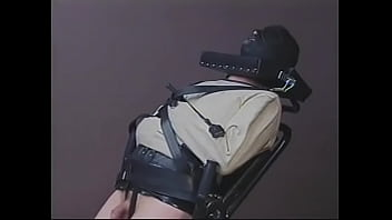 Mature dominatrix Mistress Scarlett pours hot wax on dude's balls and cock