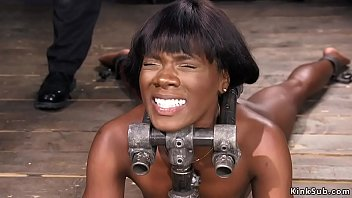Ankles in bondage - Big black ass whipped in device bondage