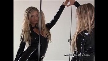 Latex loving blonde bombshell Nadia admiring herself and posing in rubber fetish outfits