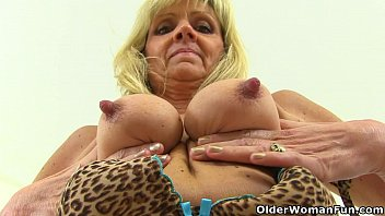 Leopard print bondage pants British gilf dolly pushes a dildo up her fanny