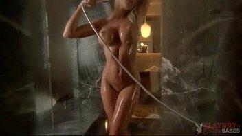 sexy blonde posing in shower