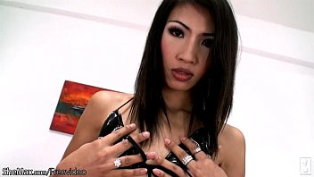 Asian femboy in latex lingerie is playing with yummy cock