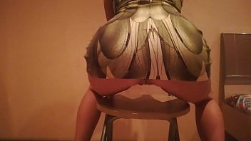 erotic dance on a chair in a dress made of snake skin