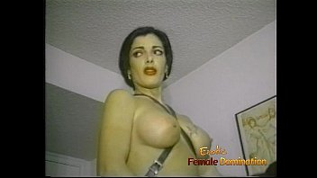 Slim raven-haired stunner makes a horny dude suck and ride a strap-on