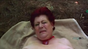 Crazy red haired granny has some hot sex outdoors
