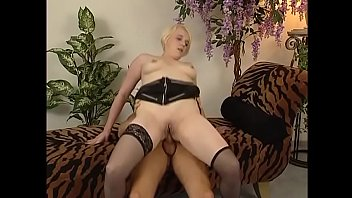 Milky skin slut in stockings gets pounded with a cock and a dildo at the same time