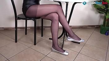 Leggy brunette under the desk shoeplay wearing pantyhose