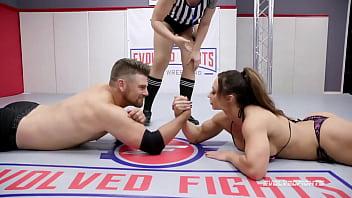 Brandi Mae arm wrestling against Jack Friday