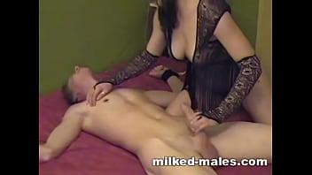 Gorgeous girl milking tied boy