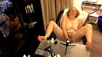 Big tit GILF gets off in hotel window MarieRocks
