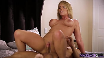Hot blonde busty MILF Rachael Cavalli massage a big cock clients body and cock