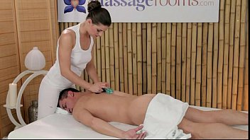 Masseuse rubs dick with tits and feet on massage table