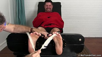 Bearded hunk tickled by a mature deviant while being bound