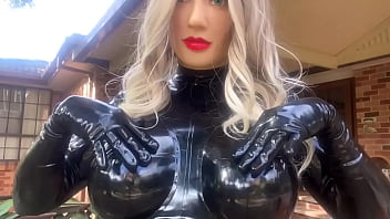Living Rubber Doll Playing with Big Latex Boobs