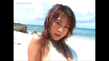 Asian Model going commando in jeans on the beach - no panties thumbnail
