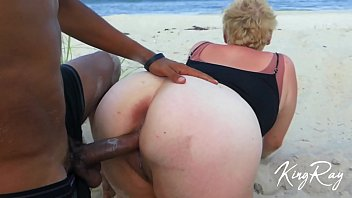 The blonde milfa suck cock and have sex on the beach