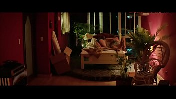 Ana de Armas rides dude in chair scene from Hands of Stone