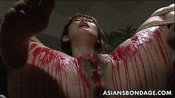 Private bondage gaping Asian babe get her privates covered in wax.
