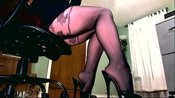 Divas lingerie Femdom holding a leather paddle