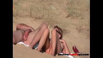 Amateurbeachspy.com - Nudist wife giving blowjob on beach