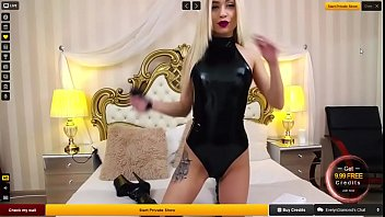 Evelyn from livecamcakez.com Rubbing Pussy In latex dress listening to Nicki Minaj
