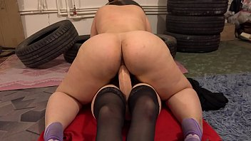 Two hairy pussies love cunnilingus and sex with a huge rubber dick. Chubby lesbians with big asses have fun in the garage.