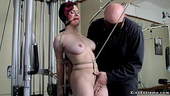 Redhead slave toyed at the gym bondage