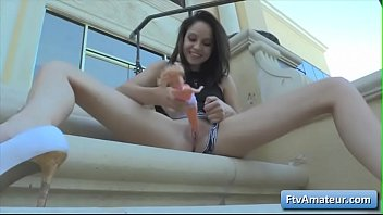 Sexy young brunette amateur Cadey rubs her clit outdoors and fuck her bald juicy pussy with a barbie doll