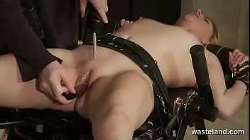 Submissive Brunette Tightly Bound With Hard Leather Straps To An Iron Table And Dominated Electrically