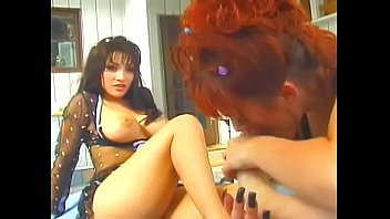 Brunette vixen eats out hot redhead chick and bangs her with strap-on